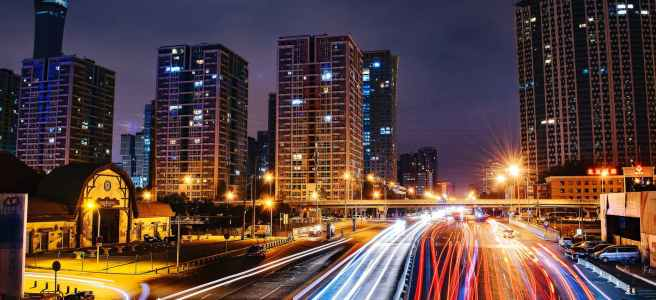 time-lapse-photography-of-city-road-at-nighttime