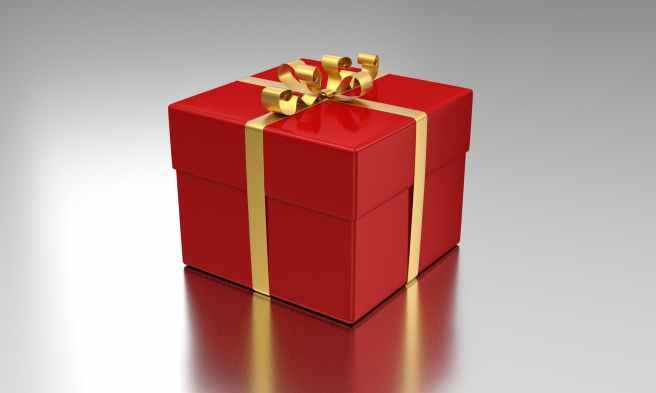 ein rotes geschenkpackerl mit goldenem geschenkband
